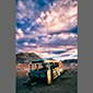 image of abandoned bus near salt mines, sunset, Atacama Desert, Chile