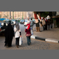 image of women in Cairo carrying flag and walking to Tahrir