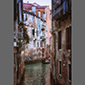 image of reflections of houses in canal, Venice, Italy