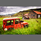 image of old red Jeep in a field in Iceland