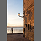image of man and water, Ortigia, Siracusa, Sicily, Italy