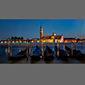 image of lagoon and gondolas at night, Venice, Italy