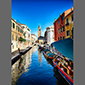 image of canal and vegetable seller, Venice, Italy