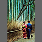 image of couple in kimonos, bamboo forest, Kyoto, Japan